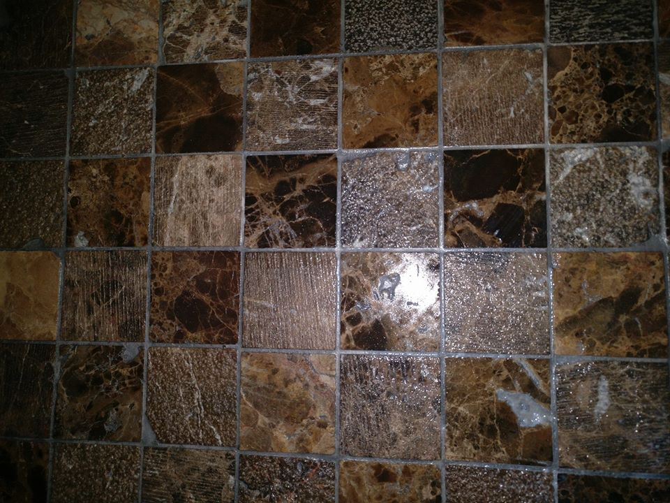 brown and grey shiny stone mosaic with grey grout