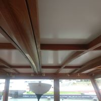 white curved ceiling with dark wood beams